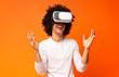 Leinwanddruck Bild - Cheerful man enjoying futuristic technologies with vr glasses