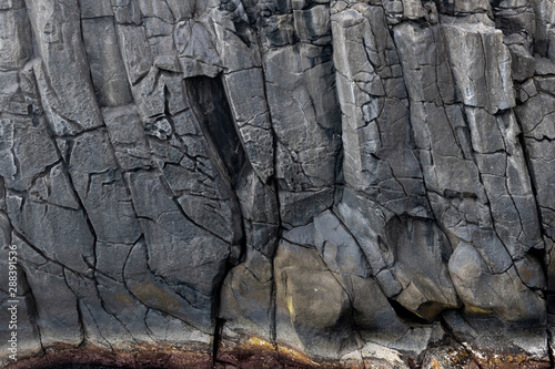 Fotografie, Obraz  Abstract black lave basalt rock formation walls at the Ponta do Mistério on Terc