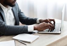 African American Employee Working On Laptop In Modern Office