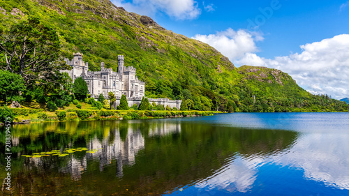 Kylemore Abbey, beautiful castle like abbey reflected in lake at the foot of a mountain Canvas Print