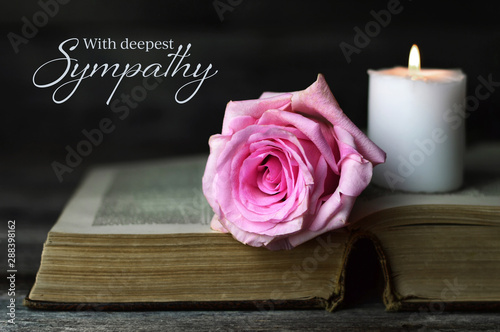 Fotografía Sympathy card with burning candle and rose on open book