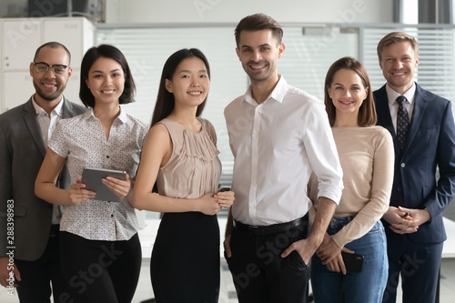 Obraz Portrait of happy group of multicultural employees. - fototapety do salonu