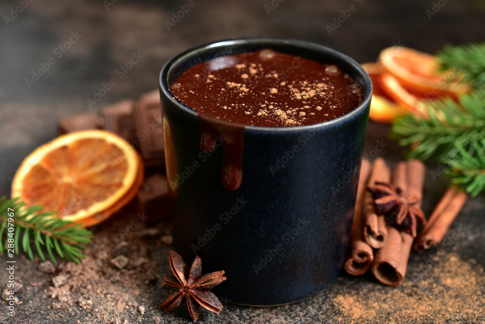 Fototapeta Homemade christmas hot chocolate with orange and spices.