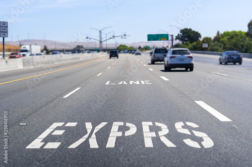 fototapeta na drzwi i meble Express Lane marking on the freeway; San Francisco Bay Area, California; Express lanes help manage lane capacity by allowing single occupancy vehicles to use them for a fee