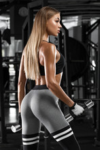 Sexy Athletic Girl Worout In Gym. Fitness Woman Doing Exercise. Beautiful Butt In Leggings