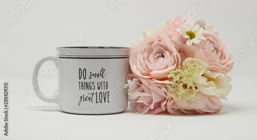 inspirational love message on a white and grey coffee mug next to a pastel bouqu Canvas Print