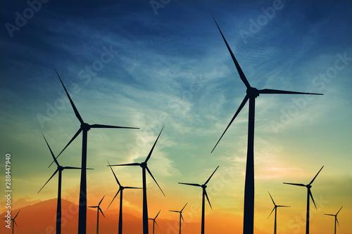 Fototapeta  concept idea eco power energy. wind turbine on hill with sunset