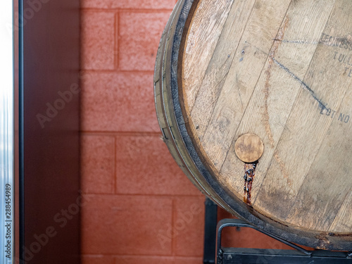 Foto auf AluDibond Schiff Leaking barrel filled with beer or wine resting in warehouse