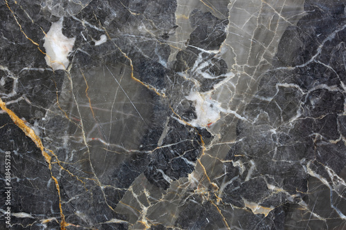 Fond de hotte en verre imprimé Marbre Patterned natural of dark gray marble pattern (Gold Russia) for interior design. Abstract nature texture.