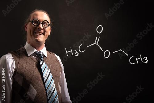 Professor presenting handdrawn chemical formula of ethyl acetate Fototapeta