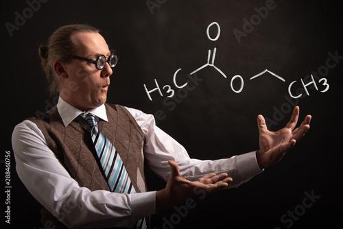 Professor presenting handdrawn chemical formula of ethyl acetate Slika na platnu