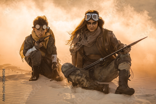 Photo  Post apocalyptic Woman and Boy Outdoors in a Wasteland