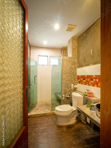 Fototapety, obrazy: Interior of bathroom with toilet in warm light