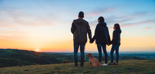 Family With Dog Embracing Whil...