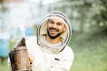 Portrait Of A Cheerful Beekeep...