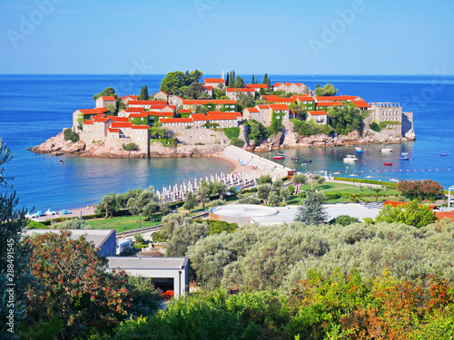 fototapeta na szkło Sveti Stefan island and beach in sunny summer day, Budva, Montenegro. Vew of top