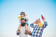 canvas print picture - Happy man family have fun together. Childhood concept. Leisure activity. Son father and grandfather playing on blue summer sky. Fathers day concept.