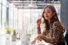 Confident Asian Businesswoman ...