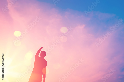Foto auf Leinwand Rosa hell Copy space of man rise hand up on top of mountain and sunset sky abstract background.