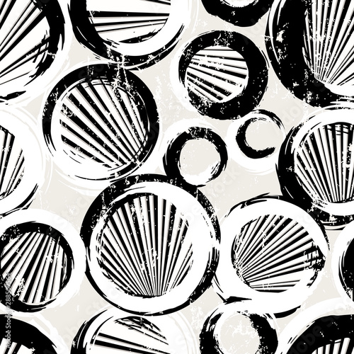 seamless background pattern, with circles, stripes, strokes and splashes, black and white
