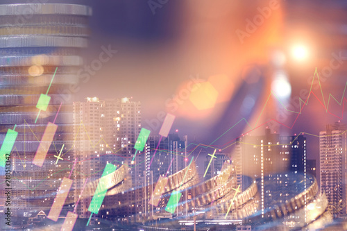 Fototapeta Financial investment concept, Double exposure of city night and stack of coins for finance investor, Forex trading candlestick chart economic , ECN Digital economy, business. obraz
