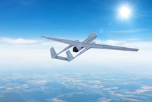 Unmanned Aerial Vehicle Drone In Flight Gaining Climbing Altitude For The Mission.