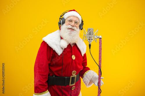 Santa Claus singing or speaking in a studio microphone Wallpaper Mural