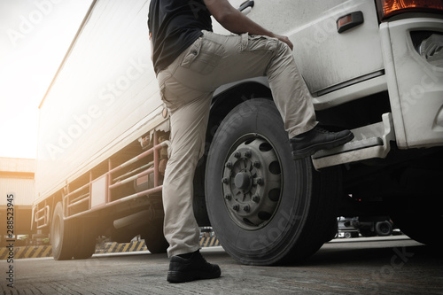 Fotografie, Obraz  truck driver opening the truck door, freight Industry and transportation