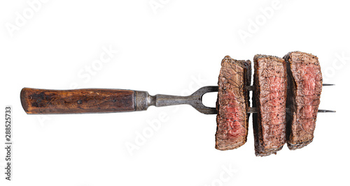 Obraz na plátně  Fork with three beef slices isolated on white