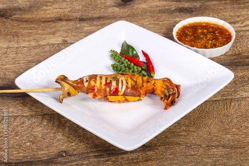 Photo  Grilled squid with sauce and hebs