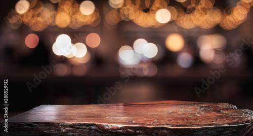 Fototapeta Wood texture table top (counter bar) with blur light gold bokeh in cafe,restaurant background obraz