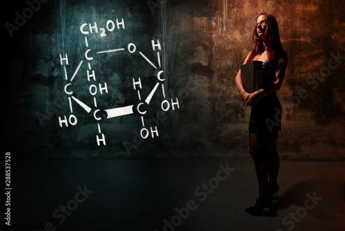 Sexy girl or secretary or female student presenting handdrawn chemical formula o Wallpaper Mural