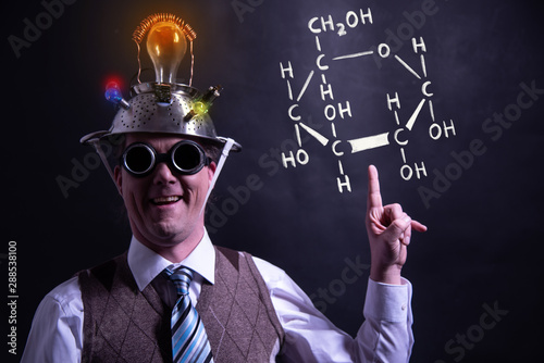 Nerd presenting handdrawn chemical formula of formic glucose Canvas Print