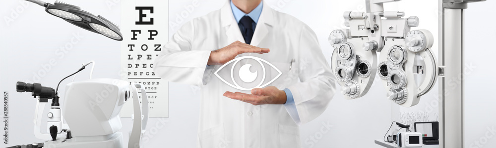 Fototapeta concept of eye examination, optician hands protecting an eye icon, prevention and control, on background tools for diagnostics, web banner