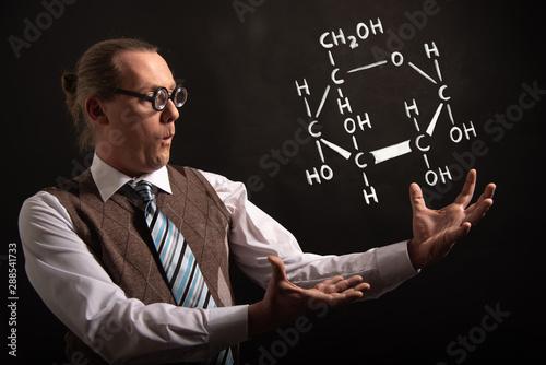 Professor presenting handdrawn chemical formula of glucose Wallpaper Mural