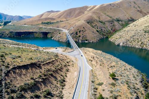 Printed kitchen splashbacks Coast Cars drive across a bridge the leads over a reservoir through a desert