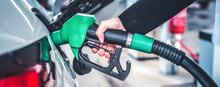 Woman Pumping Gasoline Fuel In...