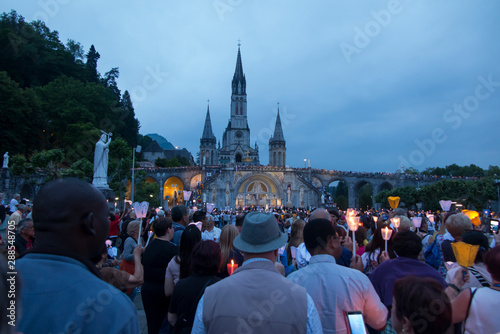 Lourdes, France, 24 June 2019: Evening procession with candles at the shrine of Canvas Print