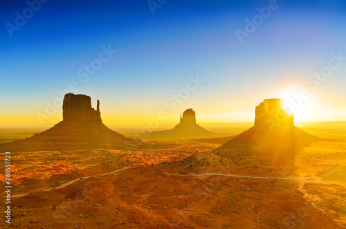 Spoed Foto op Canvas Arizona View of Monument Valley at sunrise near the border of Arizona and Utah in Navajo Nation Reservation in USA.