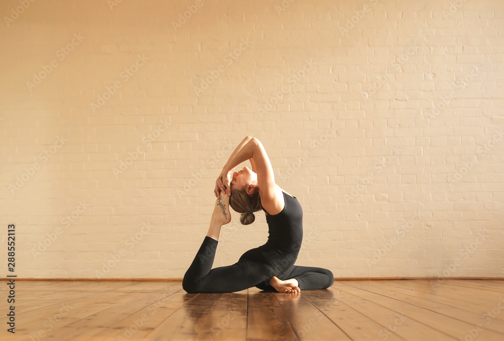 Fototapety, obrazy: Girl practicing yoga positions