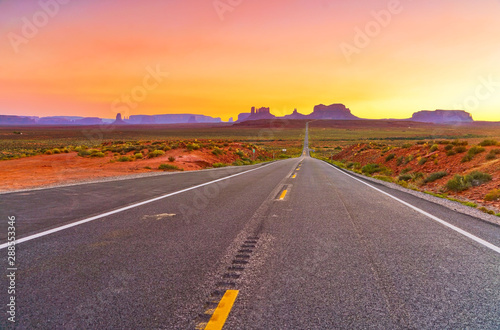 Foto auf AluDibond Lachs View of Monument Valley at sunset near the border of Arizona and Utah in Navajo Nation Reservation in USA.