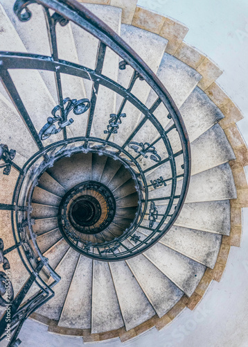 Antique stone spiral staircase in the tower of the bell tower of the Catholic Church