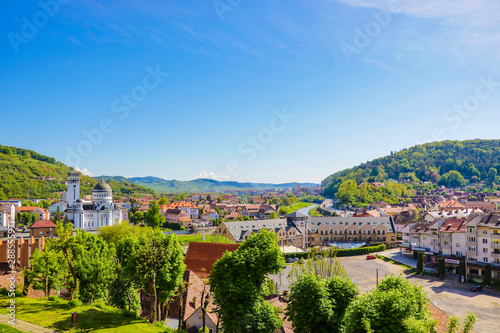 Sighisoara, Romania, May 12, 2019: Morning cityscape of Sighisoara with Sighisoara City Hall and Holy Trinity Church on background Fototapet