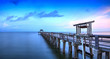 Sunrise over Naples Pier where people fish at dawn in Naples,