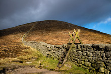 Stile Over The Mourne Wall At Hare's Gap, Mourne Mountains, County Down, Northern Ireland.