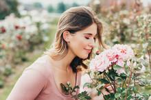 Outdoor Portrait Of Young Beautiful Woman In Summer Garden