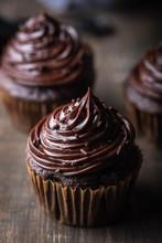 Chocolate Cupcake On Dark Wooden Background