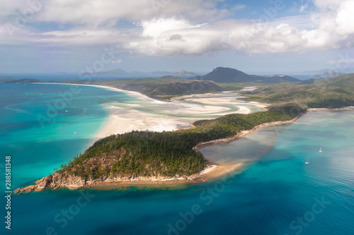 Aerial shot of Hill Inlet over Whitsunday Island - swirling white sands, sail boats and blue green water