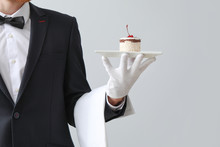 Handsome Waiter With Dessert O...