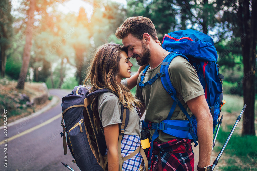 Fototapety, obrazy: Romatic couple walking with backpacks over natural background